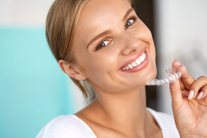 girl with clear aligner