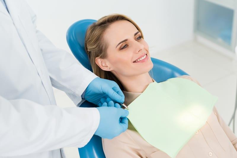 happy patient at dentist tepper